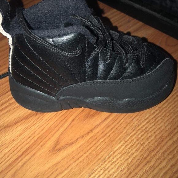 Kids pair of black Jordans.!!!